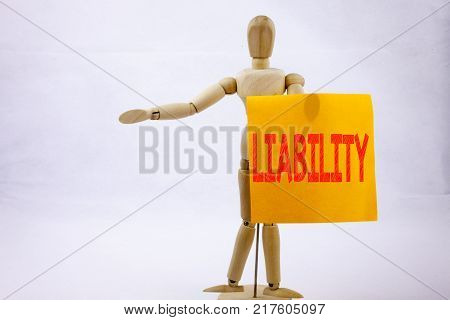 Conceptual hand writing text caption inspiration showing Liability Business concept for Accountability Legal Blame Risk on sticky note sculpture background with space
