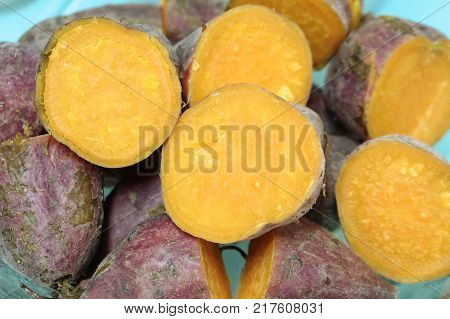 Vegetable and Fruit of Close Up of Streamed Orange Sweet Potatoes High in Vitamin A Vitamin C and Vitamin B6.