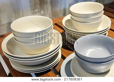 Kitchen Utensil Collection of Porcelain Dishes Bowls and Plates Preparing for Serve Hot and Cold Food.