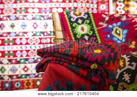 Chiprovtsi Carpets (rugs). Traditional colorful carpets from Chiprovtsi region in Bulgaria. Hand-woven (hand-made) carpets with different elements and colours. Ethnic and folk patterns.