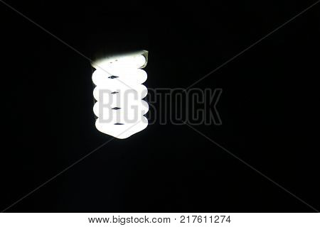 a solitary neon electric, view of a lamp post bright light