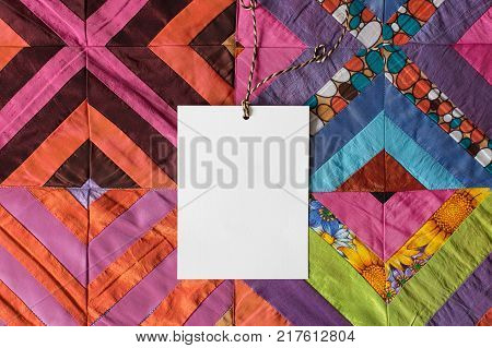 interior, present, greeting concept. strips and patterns of different fabric sewed in warm multicolored blanket, some of the pieces are monochromatic, others have such patterns as circles or flowers