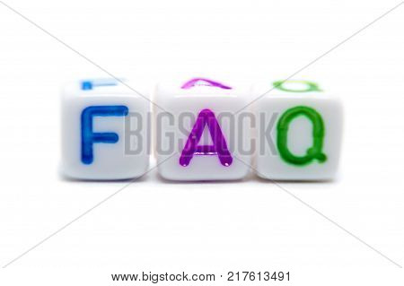 FAQ word stands for Frequently Asked Questions from letter beads on the white background