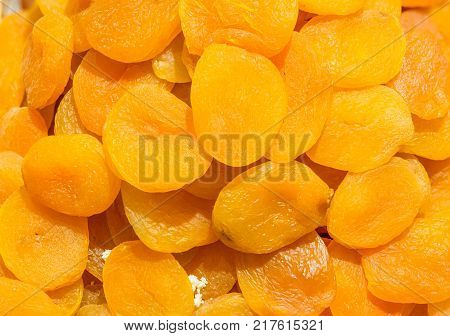 close up on dry apricot yellow background .