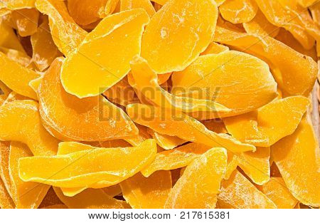 candied ginger slices as a orange background .