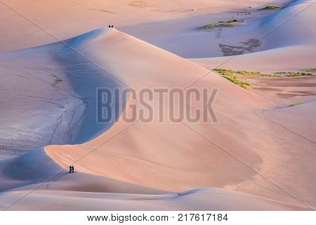 Hikers and photographers at sunrise - Great Sand Dunes National Park and Preserve in Colorado