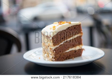 Cake Slice On White Plate In Paris, France