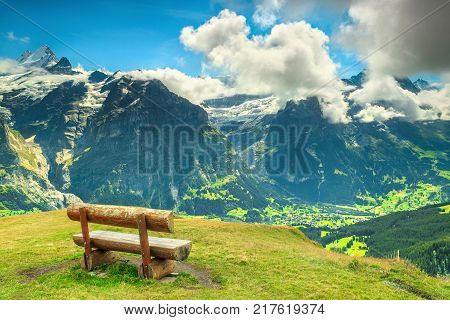 Wooden bench and resting place in high mountains with stunning panorama Grindelwald Bernese Oberland Switzerland Europe
