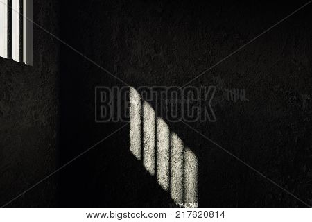 3d rendering of grunge prison cell with the shadows of stanchions projected on wall