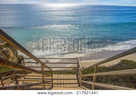 Wooden stairs lead onto El Matador State Beach in Malibu California