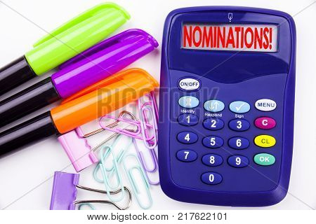 Writing word Nominations text in the office with surroundings such as marker, pen writing on calculator. Business concept for Election Nominate Nomination white background with space