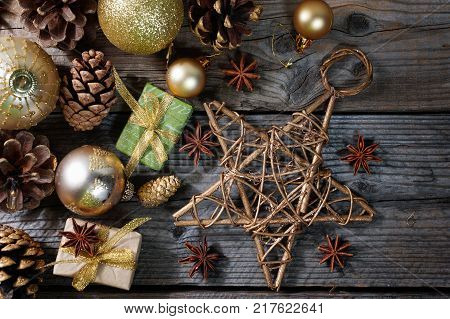 Christmas decorations with golden balls, gifts, pine cones and big star , horizontal banner, top view