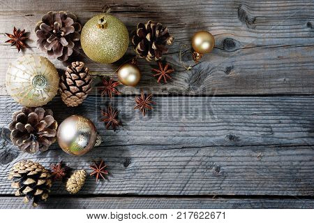Pine cones with gold christmas decoration and gifts with copy space