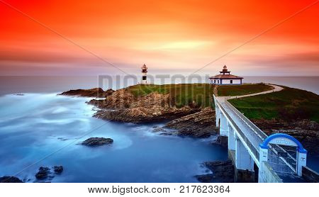 Idyllic view on seashore of Pancha island Spain at sunset of red and orange colors