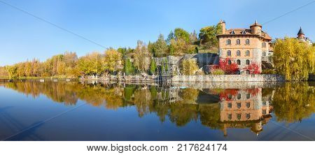 house by the lake in the landscape park in the village of Buki Ukraine