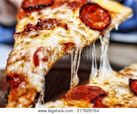 Closeup of a piece of pepperoni pizza. Italian pizza. close up