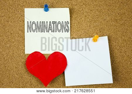 Conceptual hand writing text caption inspiration showing Nominations concept for Election Nominate Nomination and Love written on sticky note, cork background with copy space