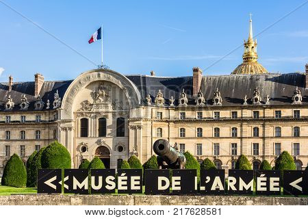 Paris France - July 02 2017: Les Invalides (The National Residence of the Invalids) is a complex of museums and monuments relating to military history of France. The northern portal of the complex with Louis XIV with horse on the pediment.