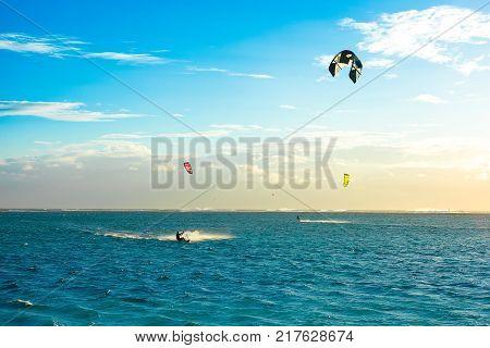 Le Morne Mauritius - 30 September 2017: Kitesurfers on the Le Morne beach - famous kite spot in Mauritius island. Sunset landscape.