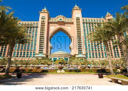 Dubai United Arab Emirates - 7 February 2016: Beachside facade of luxury hotel Atlantis the Palm in The Palm Jumeirah - artificial archipelago in the Persian Gulf Dubai UAE 7 February 2016: