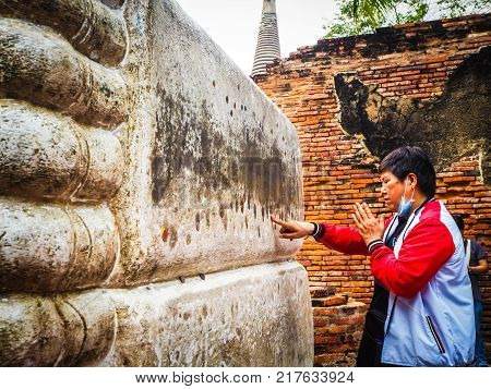 Thai People Come To Respect And Worship Buddha At Wat Yai Chaimongkol,ayuttaya Province,thailand On