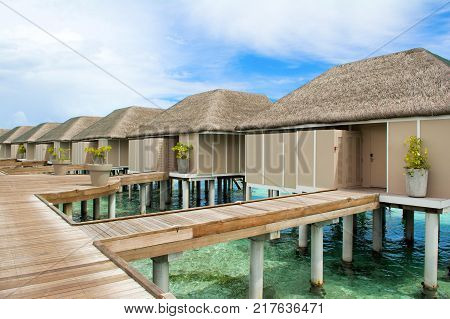 South Atoll Dhidhoofinolhu Maldives - 14 July 2017: Wooden villas over water of the Indian Ocean