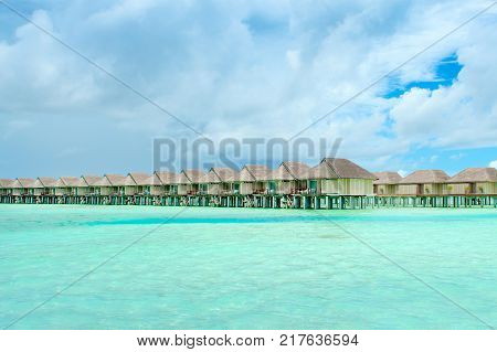 Wooden Villas Over Water Of The Indian Ocean, Maldives
