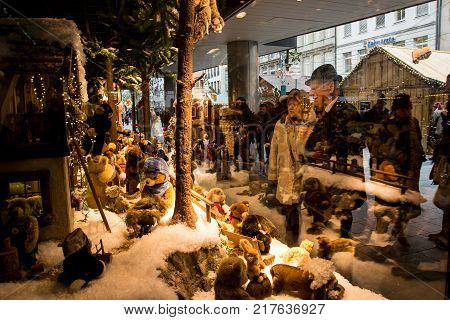 MunichGermany-Dec 062017:People wath the the traditional display of Steiff puppets in the window of the Kaufhof dept.store in Marienplatz
