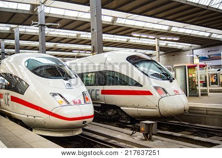 MunichGermany-Dec 062017: Two ICE high speed trains of Germany's DB German Railroad stand next to each other at Munich Central Station