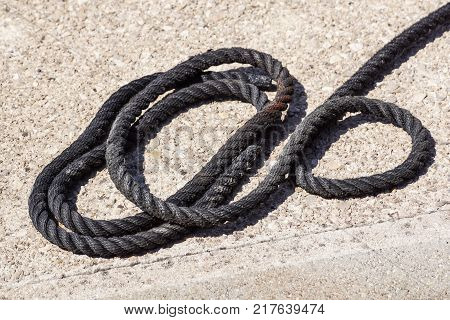 Close-up of an old frayed boat rope as background .