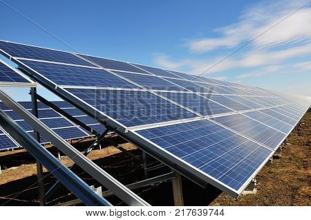 Photovoltaic solar panels in a power plant. Solar power station.