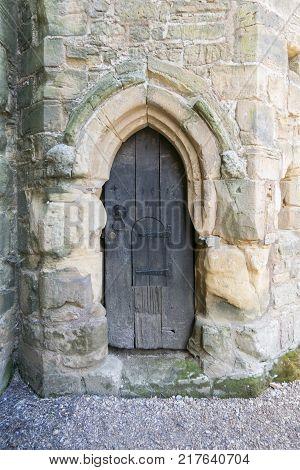 BATTLE ABBEY, BATTLE, EAST SUSSEX, UK, 13TH APRIL 2017 - Ancient wooden door in Battle Abbey Battle Sussex UK