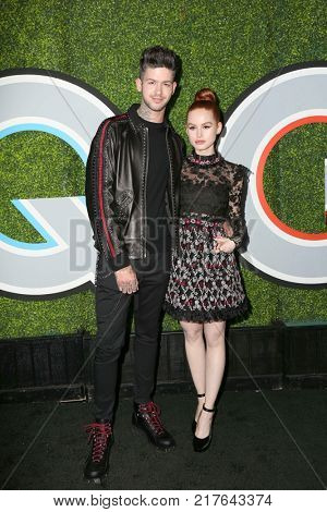 LOS ANGELES - DEC 7:  Travis Mills, Madelaine Petsch at the 2017 GQ Men of the Year at the Chateau Marmont on December 7, 2017 in West Hollywood, CA