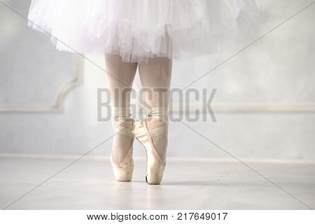 Ballerina dancing closeup on legs and shoes.