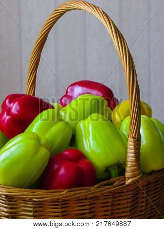 A whole basket full of colorful peppers.