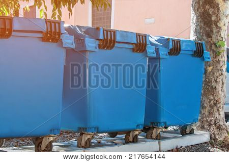 Containers for collecting and sorting different types of waste until recycling in the city. The horizontal frame.
