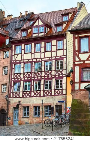 City street of Nuremberg, Germany with half-timbered houses in Bavaria