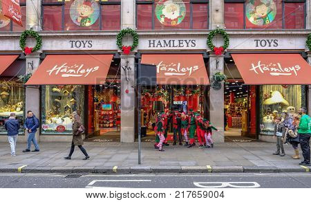 Regent Street London United Kingdom - December 5 2017: Elves having fun outside the toy store Hamleys in Regent Street. Christmas excitement.