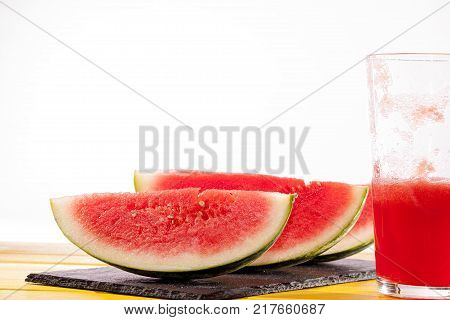 Fresh watermelon slices and juice drink. Thirst quenching refreshing summer smoothie. Healthy and nutritional food.