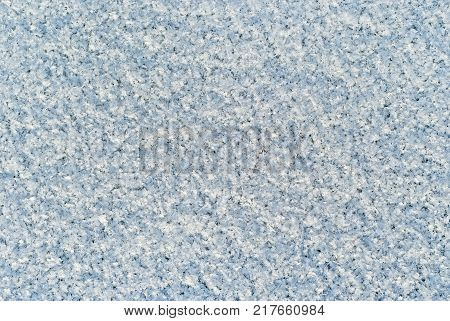 background texture: loose surface of freshly fallen snow with discernible individual snowflakes and deep blue shadows