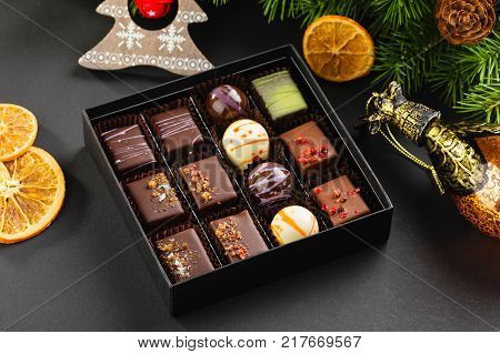 Set Of Coloful Luxury Handmade Bonbons In Box On Christmas Background