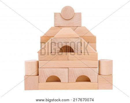 Wooden toys from which build children's houses, child development, cubic castle, with towers, front view, isolated on white background.