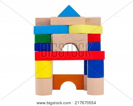 Wooden toys, child development, cubical multi colored castle, lined up for the child, at the top is a blue triangle, front view, isolated on white background.