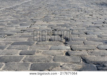 Road from paving stone, texture stones, background of old stones. Old pavement