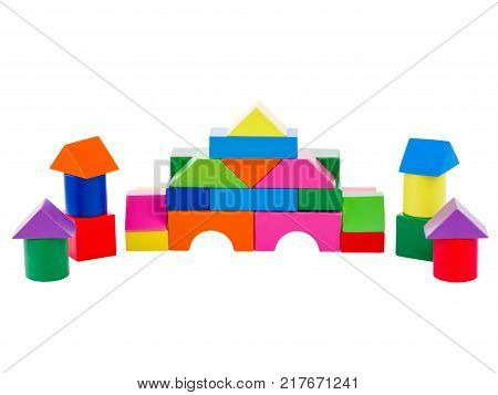 Wooden toys, child development, cubical multi-colored castle, with towers, lined up for the child, front view, isolated on white background.