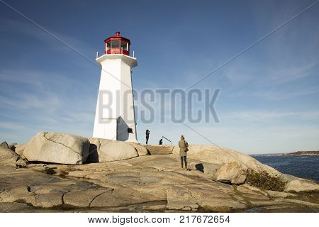 Tourists At Peggys Cove Lighthouse, Nova Scotia, Canada