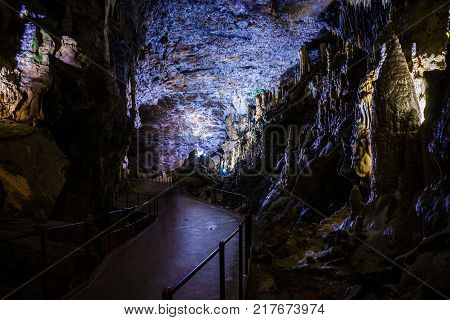 Postojna cave, Slovenia. Formations inside cave with stalactites and stalagmites. Low light image.
