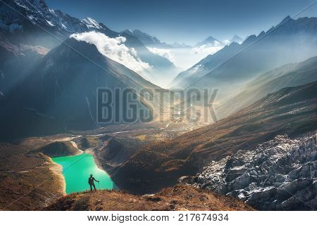 Standing Young Woman On The Hill And Looking On Mountains