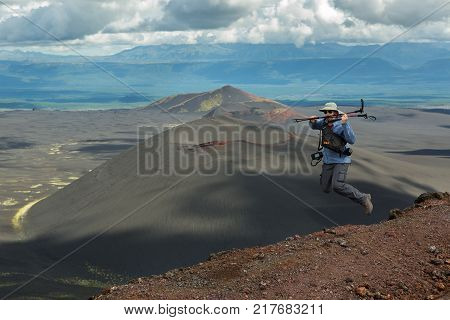 Kamchatka Peninsula, Russia - August 20, 2016: Tourist at the top of Hiking trail climb to the North Breakthrough Great Tolbachik Fissure Eruption 1975