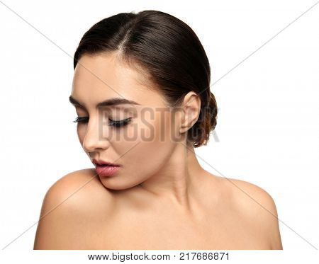 Portrait of beautiful young woman with eyelash extensions on white background